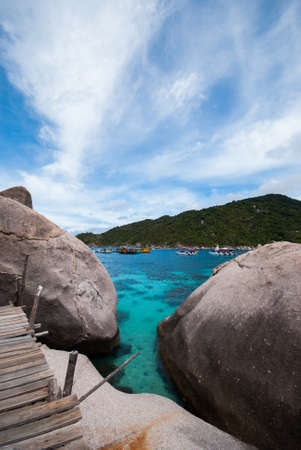 Nangyuan island of the clear ocean, blue sky in the south of Thailand photo