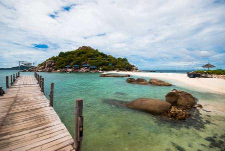 nang: wooden bridge with rock on Nang Yuan island.
