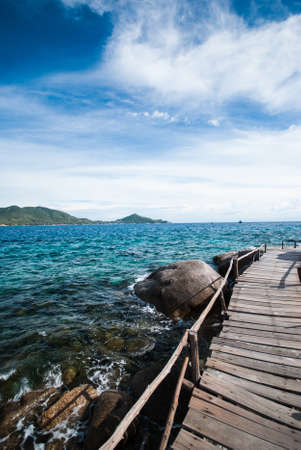 The wooden bridge at a beautiful beach Nang Yuan Island  photo