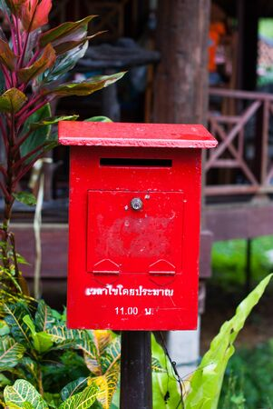 Red mailbox on a background isolated photo