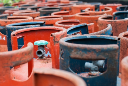 Valves of LPG cylinders red and Blue rust  Stock Photo