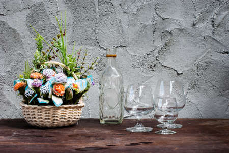 differently: Still Life flower with differently shaped glass bottles on wooden table