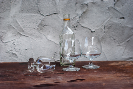 differently: Still Life with differently shaped glass bottles on wooden table Stock Photo