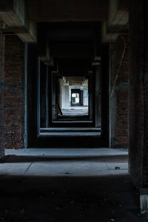 Walkway in abandoned hotel on the mountain photo