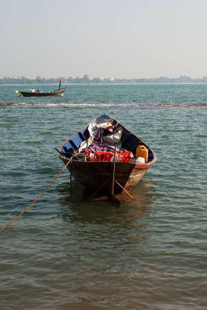 small boat moored in ocean water at Rayong Thailand photo
