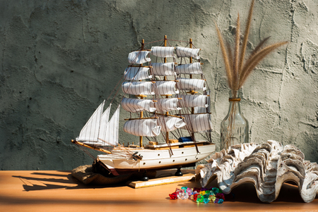 wooden sail ship toy model with shells on the table photo