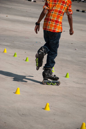 Boy skating on the rollerblades at stadium photo