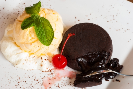 Chocolate fondant with vanilla ice cream and Cherry , dessert cake  photo