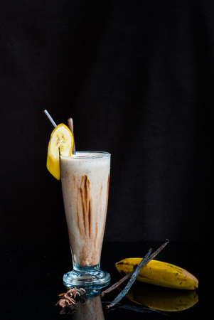 chocolate smoothie with bananas and peanut butter on Black background