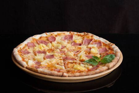 Hawaiian Pizza , pineapple , ham and cheese on wooder table photo