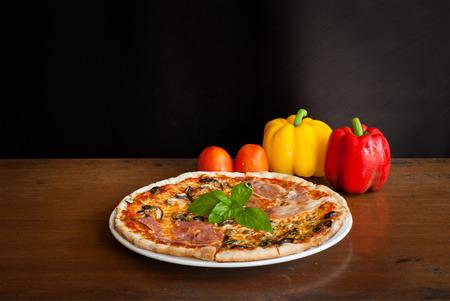 four season: Four Season Pizza slice on the wooden table