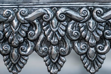 Oriental silver surround pattern of metal stamping in Chiang Mai photo