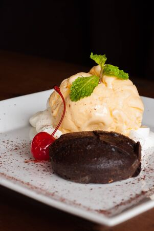 Hot Chocolate Pudding , Fondant au chocolat with vanilla icecream photo