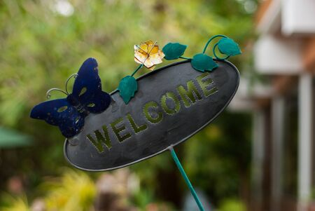 come home: Welcome Sign on Vintage Label in morning