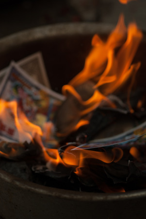 ancestor: ancestor Worship on Chinese New Year and burning paper gold