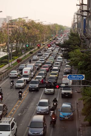 congested: BANGKOK - FEB 16: Traffic nears gridlock on a city centre road during evening rush hour , Thailand. Annually 150,000 new cars join the congested streets of the Thai capital.