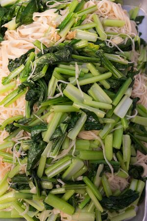 stir up: close up Stir Fried Chinese Noodles Style with kale Stock Photo