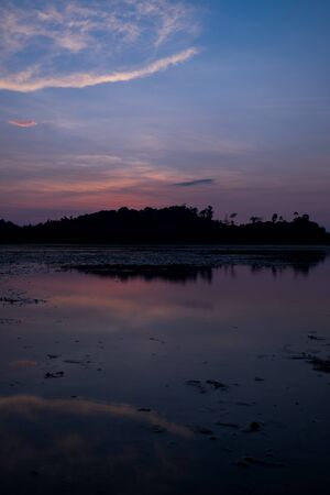 the beach with reflection in water during sunset.Thailand photo
