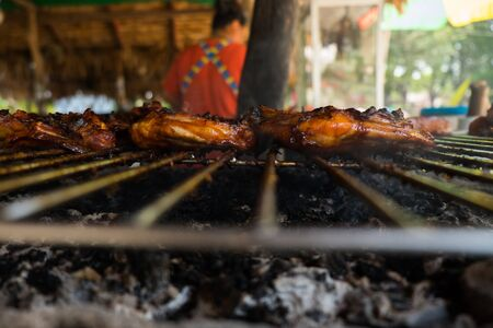 charred: Roast chicken leg on grill in the restaurant