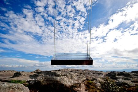 hammock: wooden hammock on Sky and mountains Stock Photo