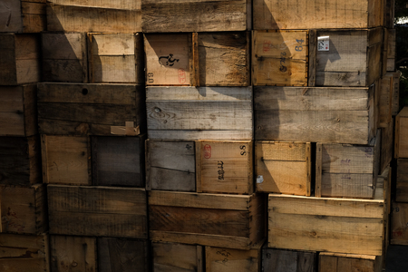Grunge Crates stack. weathered wooden boxes background. Stock Photo
