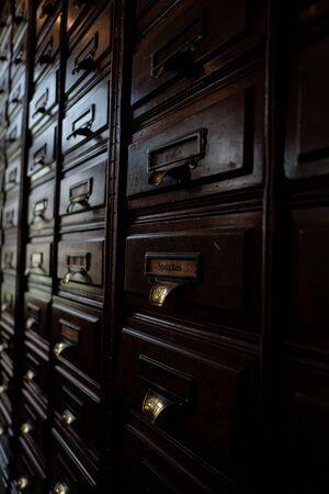 drawers: Old brown wooden drawers close up Stock Photo