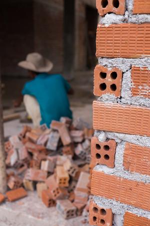 brick mason: Close up construction mason worker bricklayer installing brick walls