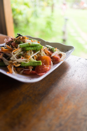 dishy: spicy papaya salad with salted crab this dish with tomato