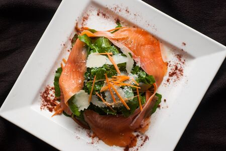 Appetizer Smoked salmon salad with rocket
