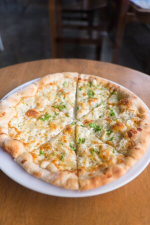 White Pizza , garlic and Mozzarella Cheese on white plate Stock Photo