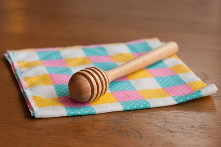 honey spoon on a wooden table  Stock Photo