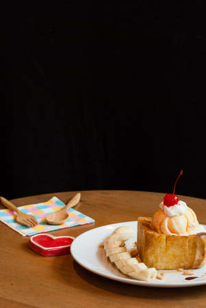 Honey toast with ice-cream and banana top cherry
