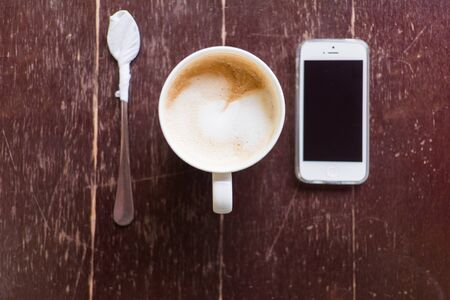 Latte coffee on wooden table - vintage style pictures