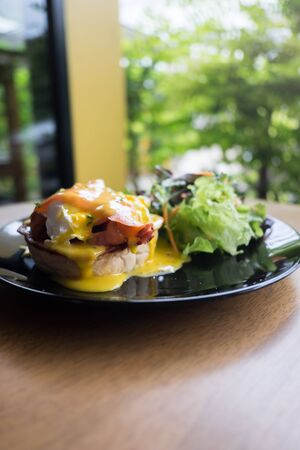 benedict: Eggs Benedict on toasted muffins with salad
