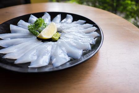fresh raw Squid sashimi on plate, Japanese cuisine