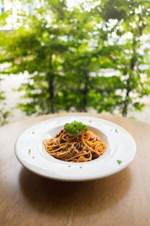 spaghetti pasta with tomato sauce and Parsley