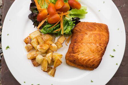 salmon steak with roast potato and salad,Grilled salmon Stock Photo