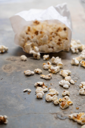 Homemade Popcorn in a White Bag on wooden
