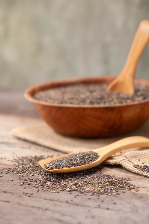 Super Food Chia seeds in a wooden spoon on the table Stock Photo