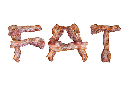 Bacon shaped as the word FAT on white background hot tasty crispy Stock Photo