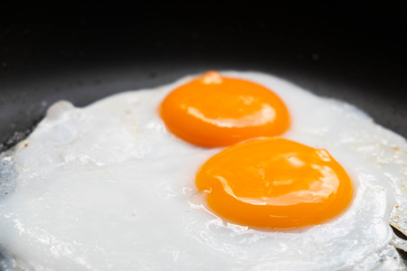 Fried eggs in pan delicious healthy easy breakfast on table Stock Photo
