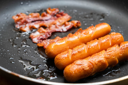 Bacon and sausage in a pan for breakfast