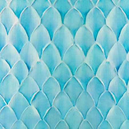 Blue decorative plaster on the wall, abstract background, imitation of scale Standard-Bild - 167128648