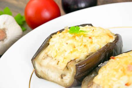 Stuffed eggplant and fresh Tomatoes. Studio Photo Stock Photo