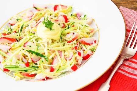 dietary: Dietary Salad with Crab Sticks, Cucumber and Cheese Studio Photo Stock Photo