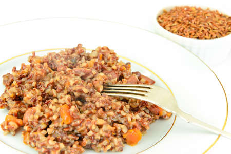 creole: Healthy Food: Pilaf with Meat and Red Rice. Studio Photo Stock Photo
