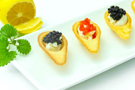 Tartlets with Red and Black Caviar. Studio Photo