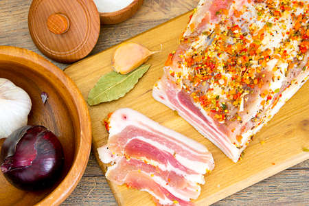 meaty: Salted Lard, Raw Pork with Spices on Wooden Cutting Board