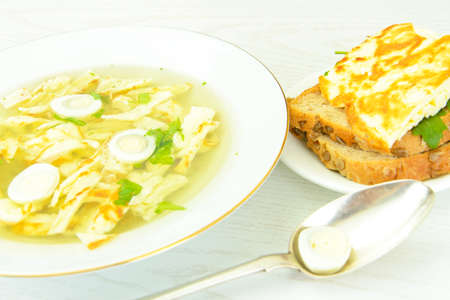 Healthy and Diet Food: Soup Egg Omelette. Studio Photo