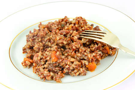 Healthy Food: Pilaf with Meat and Red Rice. Studio Photo Stock Photo